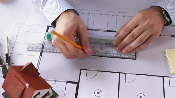 Thumbnail for Architect Hands with Ruler Measuring Blueprint