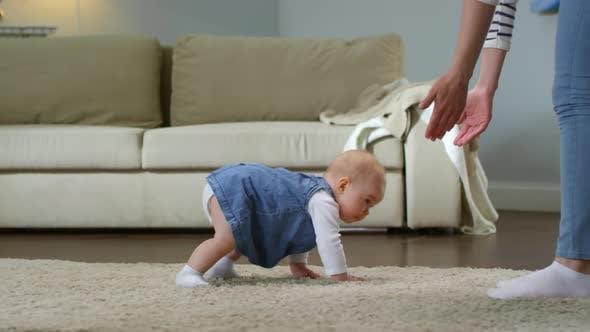 Baby Girl Crawling Towards Mom