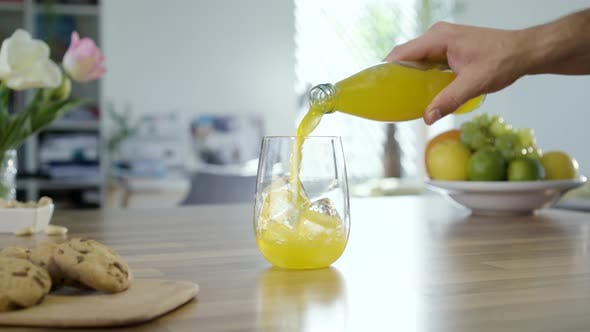 Filling Glass With Yellow Soda Drink