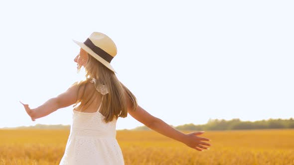 Thumbnail for Happy Girl in Straw Hat on Cereal Field in Summer