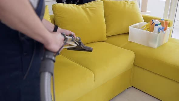 Thumbnail for Cleaning Service Using Vacuum Cleaner and Hoovering the Light Green Sofa