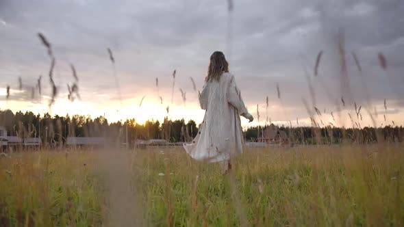 Thumbnail for Happy Woman Running in Rural Field Towards Sunset Sky