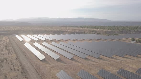 Thumbnail for 4k Aerial View. Flying Over The Solar Power Plant With Sun