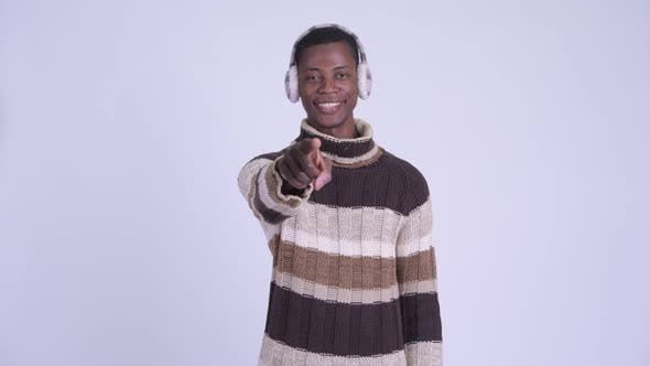 Thumbnail for Young Happy African Man Pointing at Camera Ready for Winter