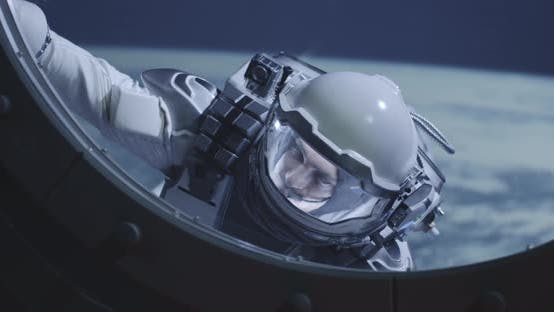 Astronaut Floating By Spacecrafts Window