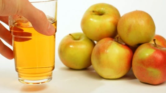 Thumbnail for Drinking Apple Juice from a Glass
