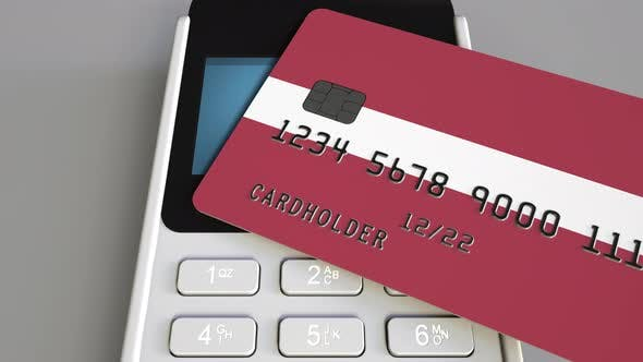 Cover Image for Bank Card with Flag of Latvia and POS Terminal