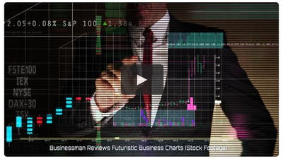 Businessman Reviews Futuristic Business Charts