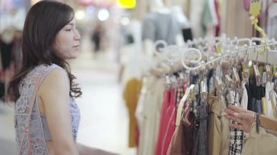 young woman shopping in a clothing store