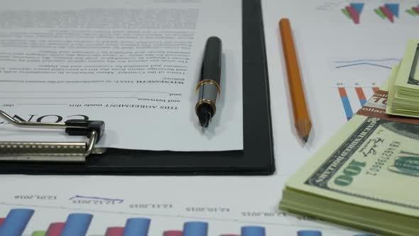 Cover Image for Business Contract And Successful Transaction And Dollars