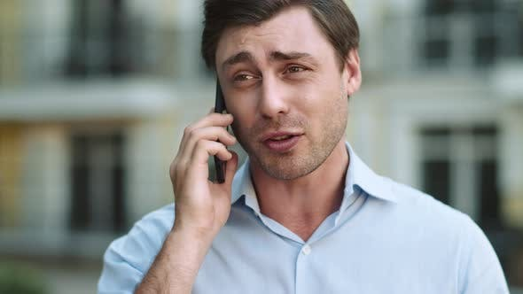 Thumbnail for Portrait Serious Man Having Phone Talk. Angry Businessman Talking on Smartphone