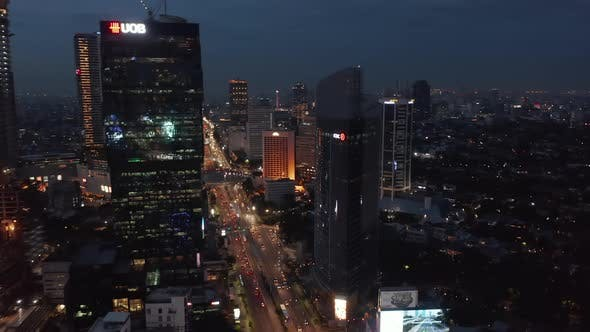 Thumbnail for Aerial Dolly Shot Flying Towards Skyscrapers Above Busy Night Traffic on the Highway in Jakarta