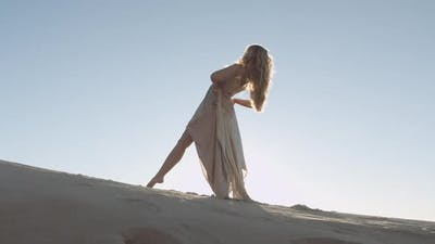 Graceful And Beautiful Woman Dancing On Sunny Sand
