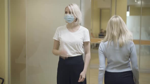 Positive Woman in Coronavirus Face Mask Waving People Leaving Auditorium After Art Lesson