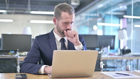 Thumbnail for Young Businessman Having Coughing While Working on Laptop