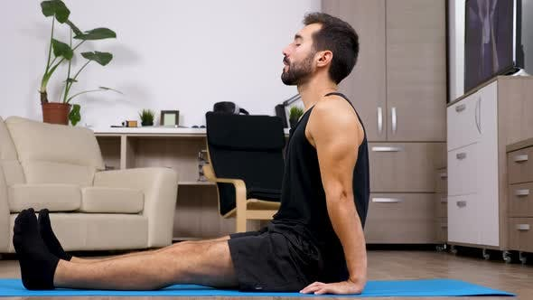 Thumbnail for Man Relaxing in Different Yoga Poses on a Blue Mat