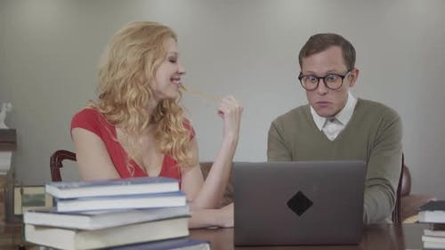 Portrait of Young Man with Glasses Enthusiastically Tells a Story of a Beautiful Seductive Girl