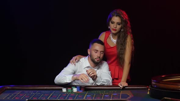 Thumbnail for Man and Beautiful Girl in the Casino Wins in Roulette