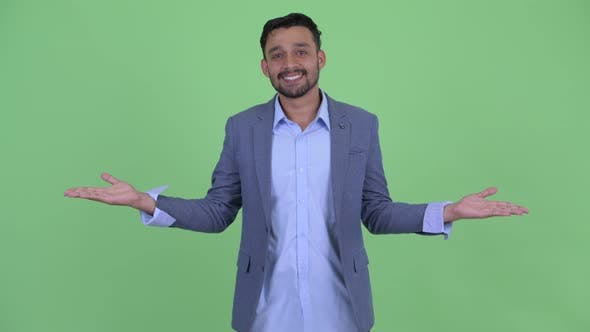 Thumbnail for Happy Young Bearded Persian Businessman Comparing Something
