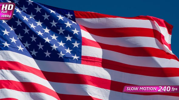Thumbnail for American Flag Is Flying In The Wind On A Sunny Day