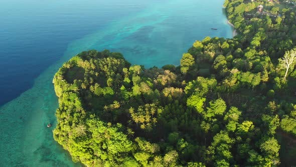 Thumbnail for Aerial ropical paradise pristine beach rainforest blue lagoon Banda Islands Indonesia