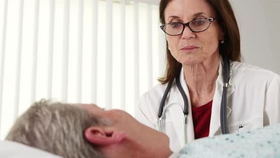 Thumbnail for Professional doctor talking to elderly patient