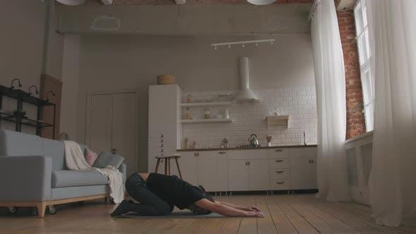 Man Practicing Yoga at home