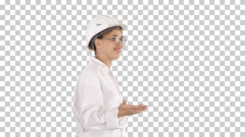 Young Scientist in Lab Coat and Hardhat Walking and Saying Something