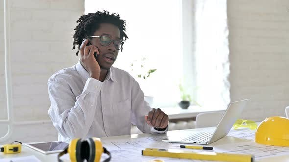 Thumbnail for African Engineer Talking on Phone