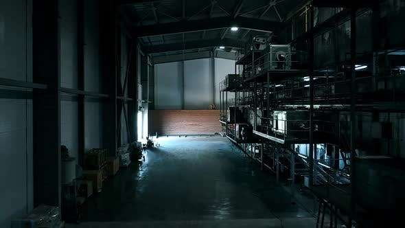 Thumbnail for Warehouse with Huge Iron Compressors. Warehouse in the Dark After a Working Day. Huge Dark Shelves