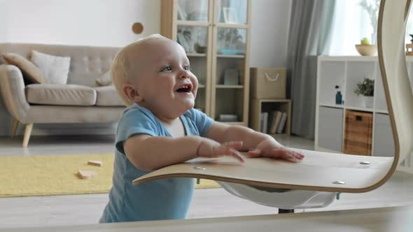 Thumbnail for Toddler Playing with Chair