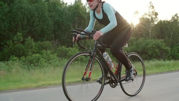 Thumbnail for Female Athlete Training for Road Bicycle Race