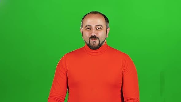 Thumbnail for Full Caucasian Man Looking at Camera and Flirting Smiling. Green Screen. Slow Motion