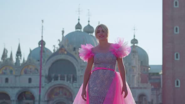 Girl with Pink Dress Walks in Front of the Basilica of San Marco