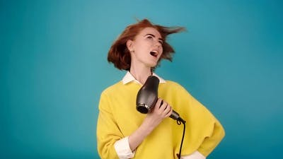 Lady in Yellow Sings Into Hairdryer