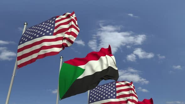 Thumbnail for Waving Flags of Sudan and the USA on Sky Background
