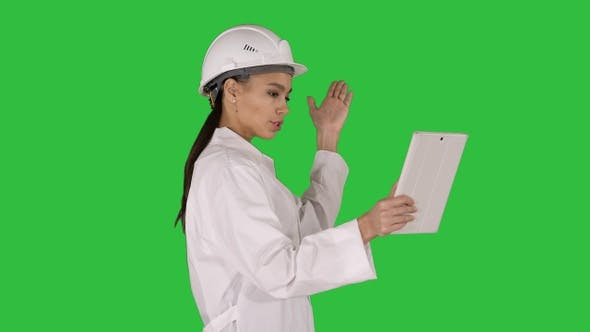 Thumbnail for Woman engineer with tablet making video call on a Green