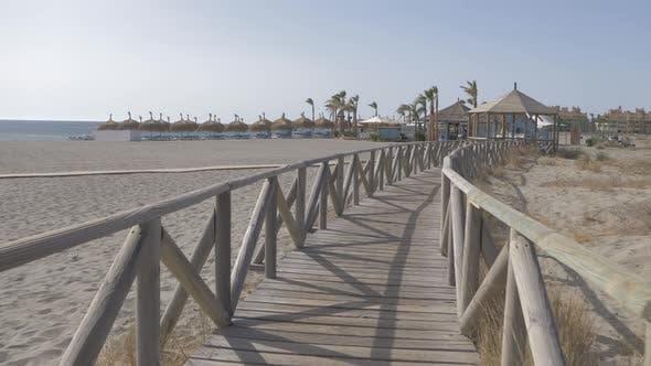 Thumbnail for Pasarela de madera. Chiringuito de playa Medterranea en 4K