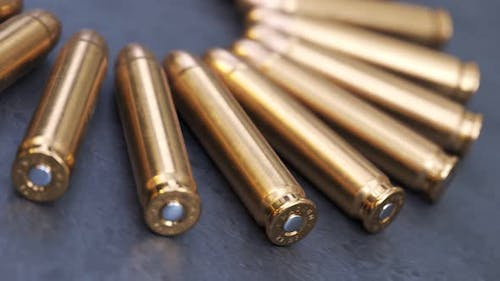 Pistol ammunition laying on a production line.. Countless amount of deadly ammo.