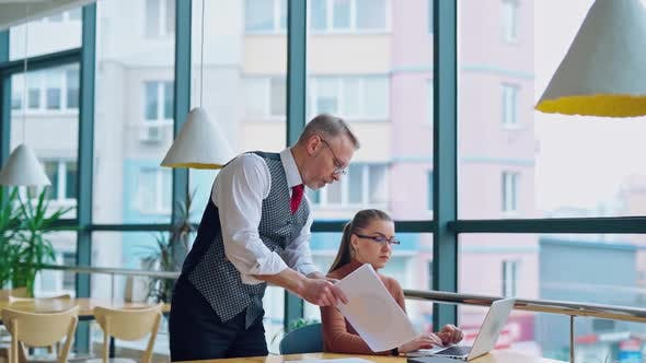 Thumbnail for Mature entrepreneur with young secretary at work