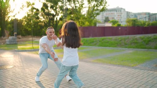 Daughter Runs to Dad and Hugs Him