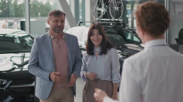 Thumbnail for Car Dealership Employee Talking to Couple