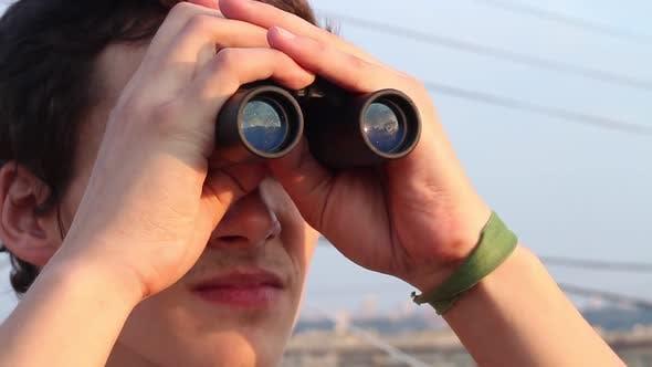Thumbnail for Man Looking Through Binoculars