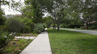 Walking On A Concrete Paved Rural Sidewalk