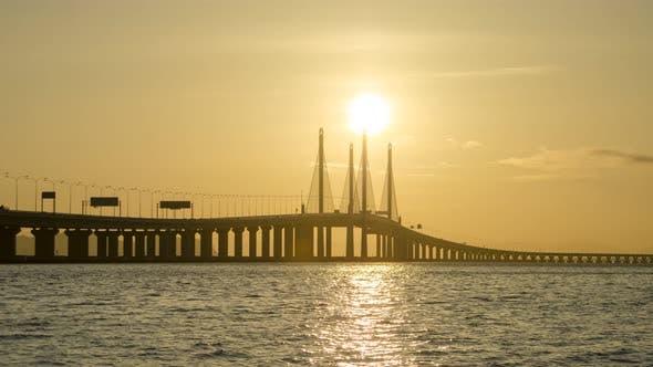 Timelapse sunrise over a bridge