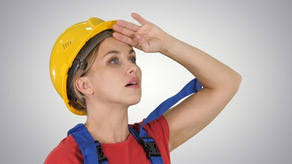 Thumbnail for Engineer construction worker woman fascinated by the scale