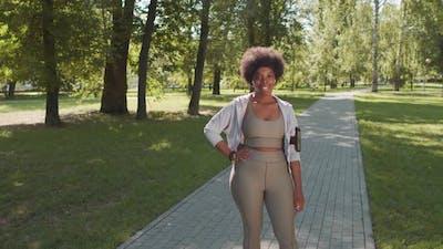 Portrait of African American Woman in Sportswear Outdoors