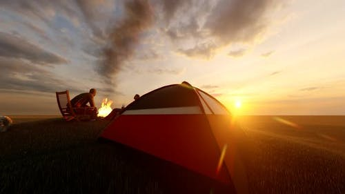 Couple Camping Out at Sunset