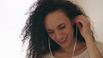 Woman putting on an earphone