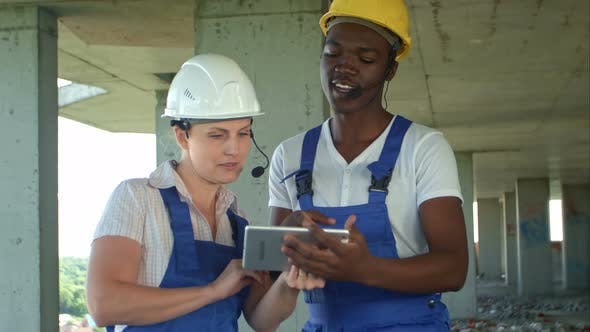 Thumbnail for Engineers on Building Site Using Digital Tablet and Talking